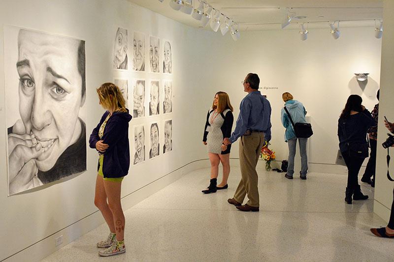 Students at BFA exhibition reception