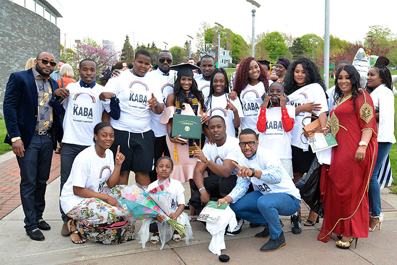 Graduate Cire Kaba with family and friends