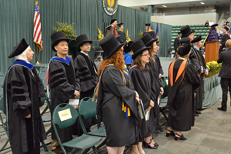 Faculty and platform party in top hats