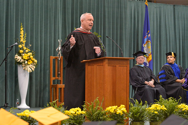 Thomas Schneider speaking at Commencement