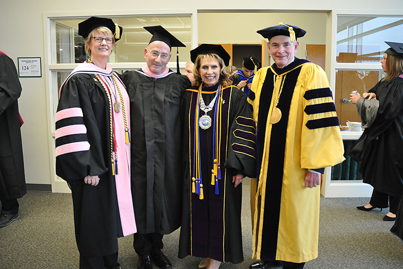 Commencement speaker Richard Einhorn with Oswego leadership
