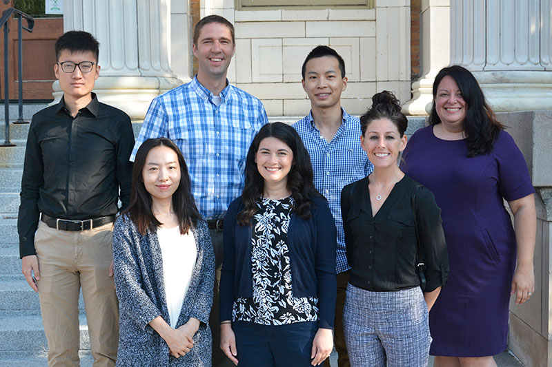 New faculty members on steps of Sheldon Hall