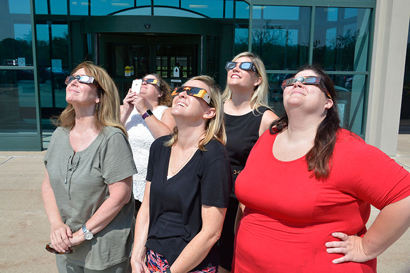 Staff viewing solar eclipse