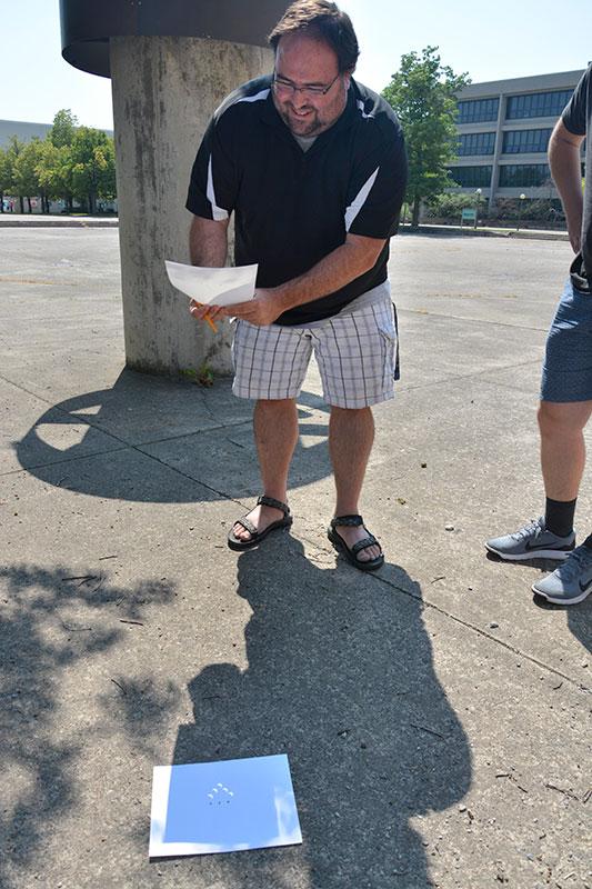 Dan Laird views eclipse through pinhole camera