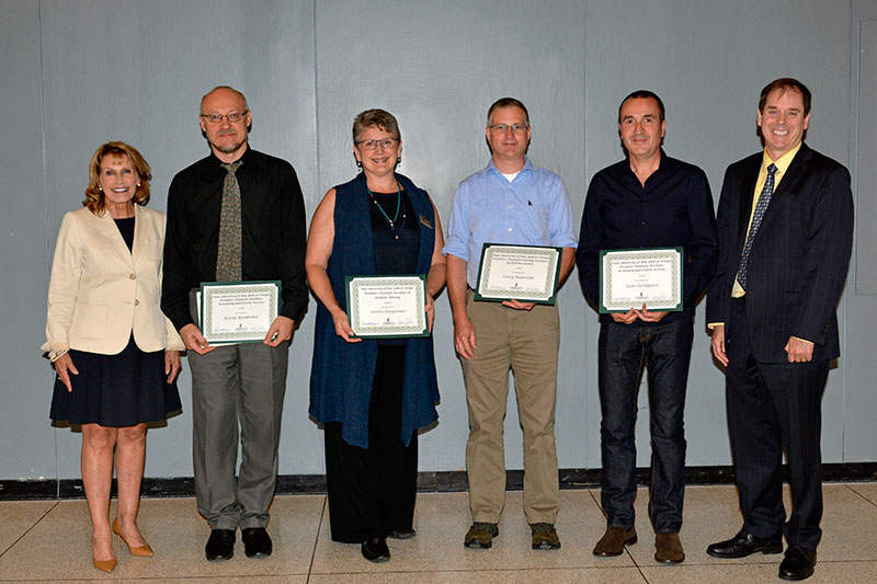 President Stanley with faculty award winners