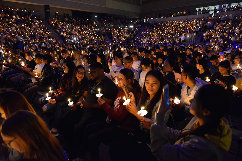 Students holding candles at Torchlight