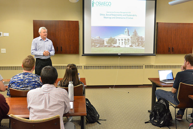 James Rogers '76, senior contracts manager/consultant for engineering company WorleyParsons, speaks to class