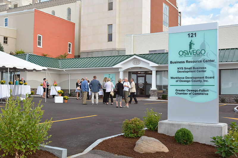 Attendees of Open House for SUNY Oswego's Office of Business and Community Relations new locations