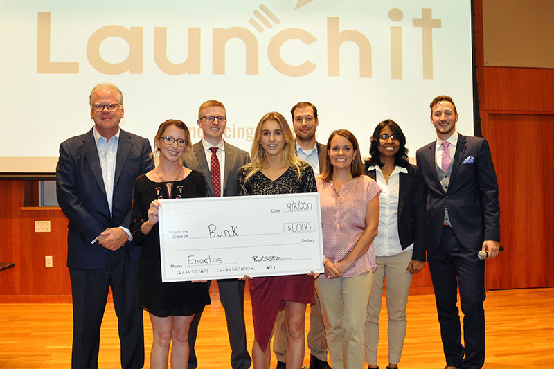 Winners of Launch It contest with judges and organizers
