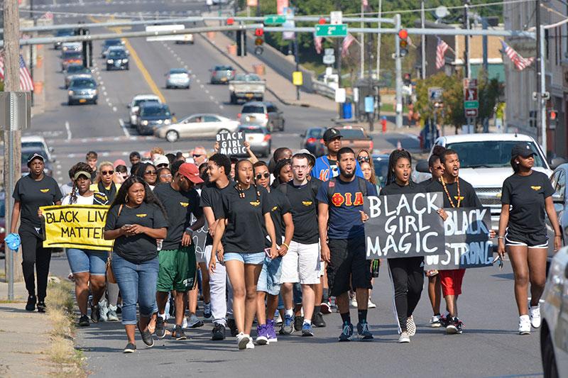 Students, administrators walk down Bridge Street for ALANA Unity Peace Walk