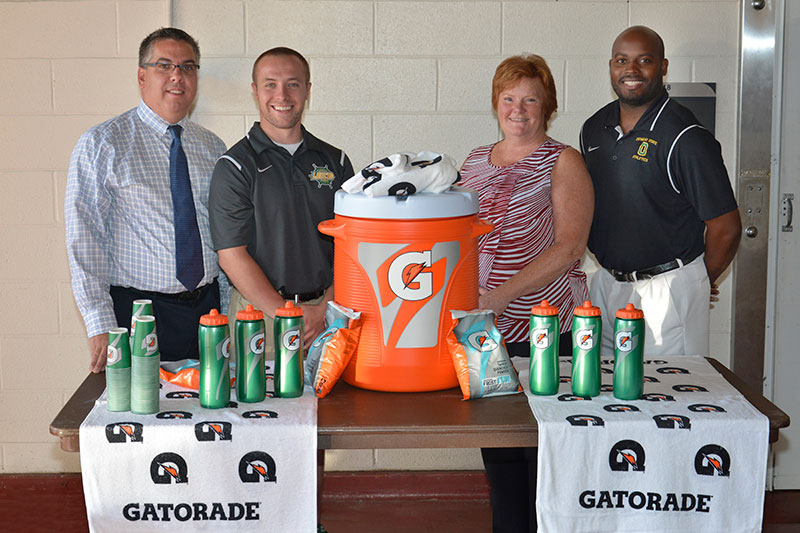 College and Pepsi representatives with Gatorade donation