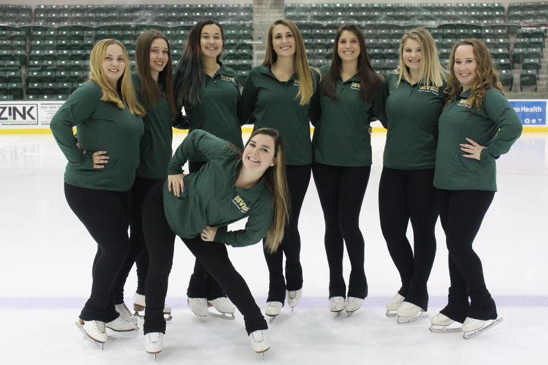Members of the Ice Effects, SUNY Oswego's student synchronized skating team, gather