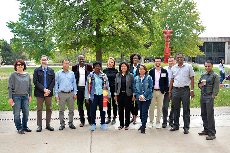 Ulises Mejias leads visiting Humphrey Fellows on campus tour