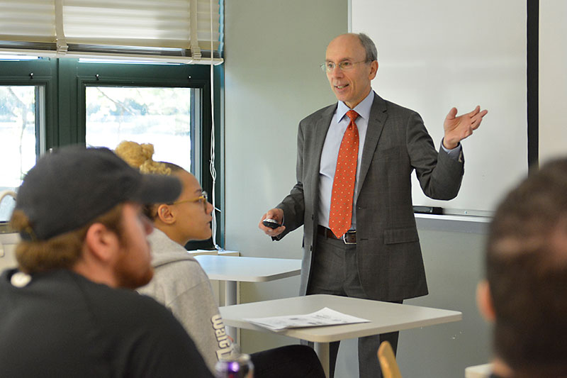 Distinguished Professor Richard Rosenfeld speaks to trauma studies class