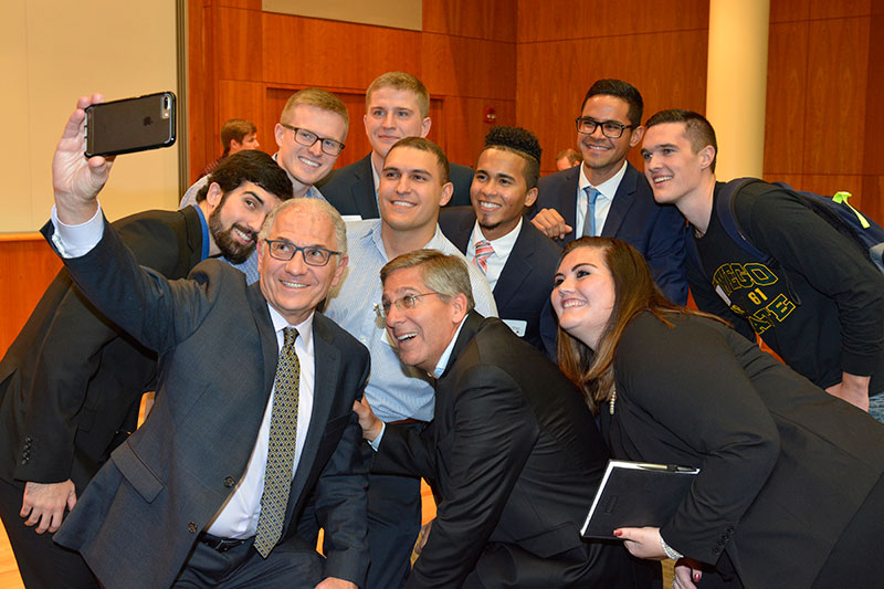 Bob Moritz poses with interns, recent hires