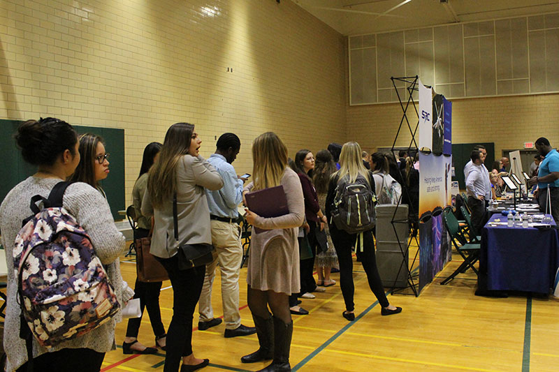 Students line up as the Fall Career Fair offers students a quick professional photo sesssion to add to their LinkedIn