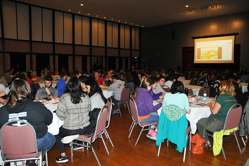 Tables of students taking part in bingo fundraiser