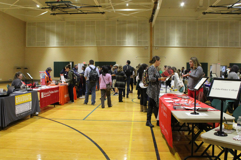 Students interested in graduate opportunities visit tables staffed by more than 80 colleges and universities during Graduate and Professional Schools Fair