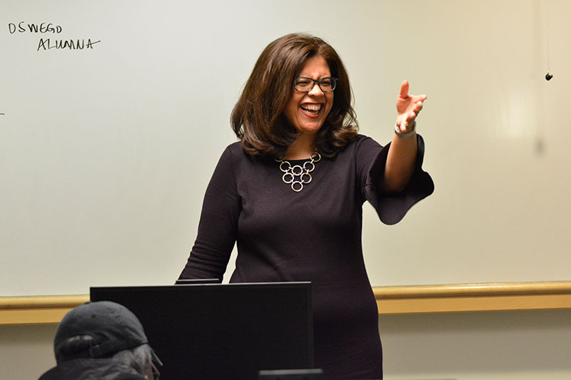 Trudy Perkins gestures while speaking to a class