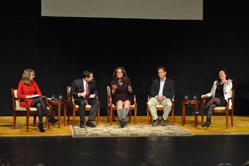 Media summit panelists share a laugh on stage