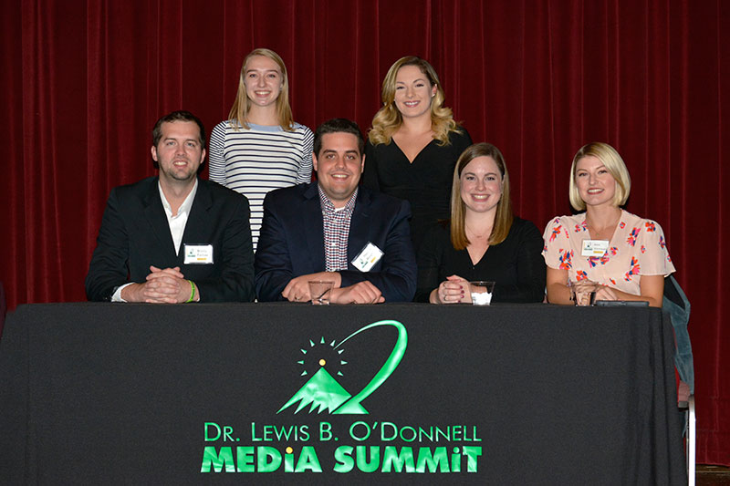 Career Connectors, alumni working in communications, and organizers of the event post after their panel presentation