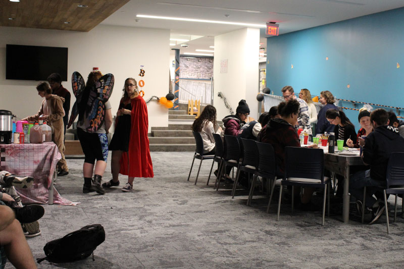 Students in costume participate in Halloween party