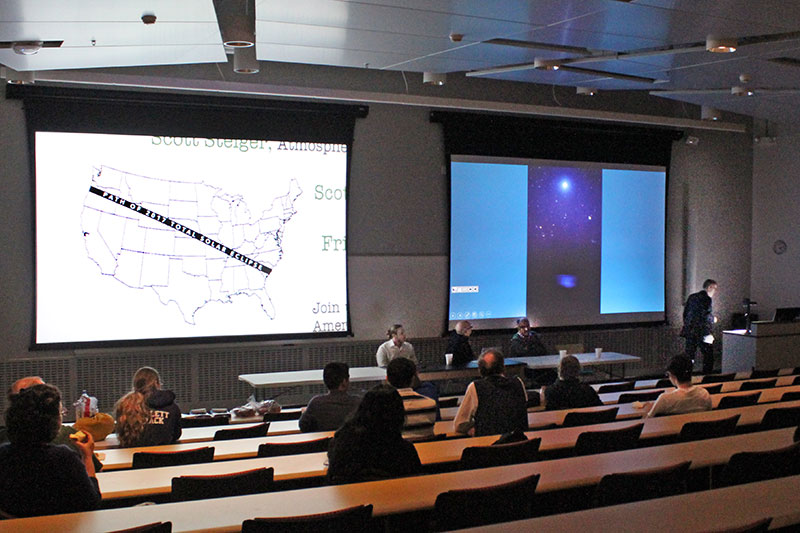 Moderator Scott Roby of the physics department, at the podium, shows the path of the Aug. 21 total eclipse of the sun
