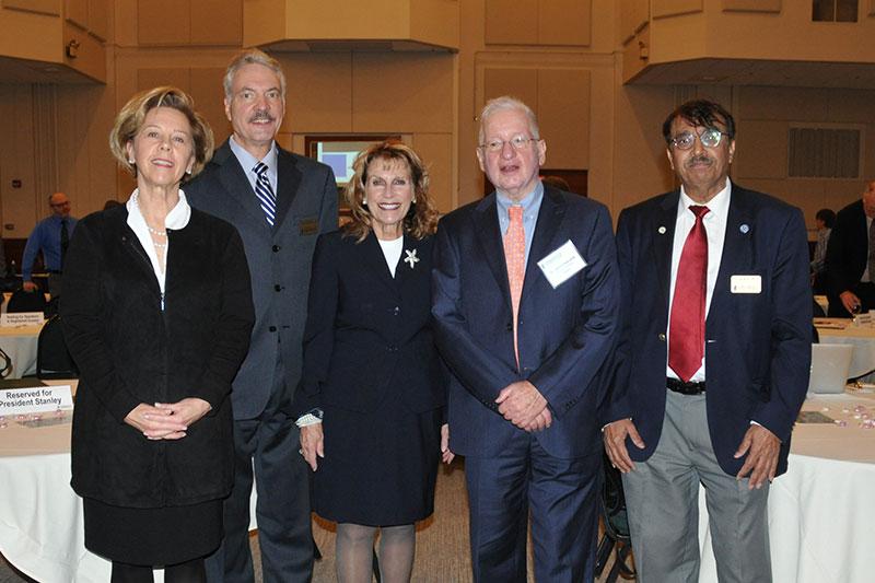 SUNY Oswego administrators and keynote speaker Henry Etzkowitz pause during incubator conference