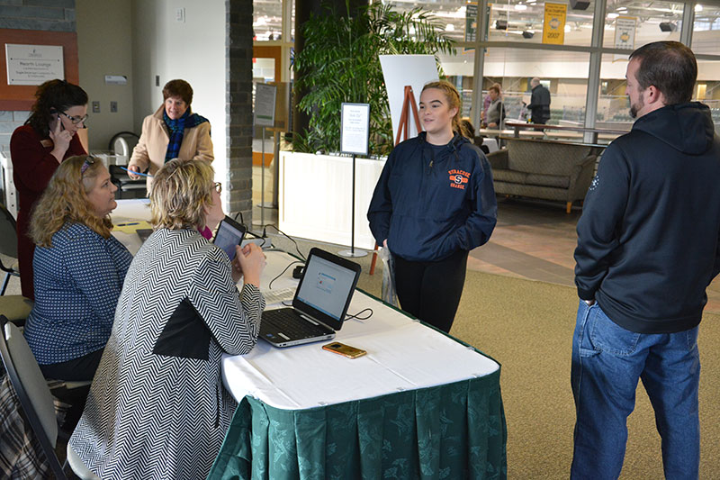 Visitors speak with experts in AskOz pop-up student support center