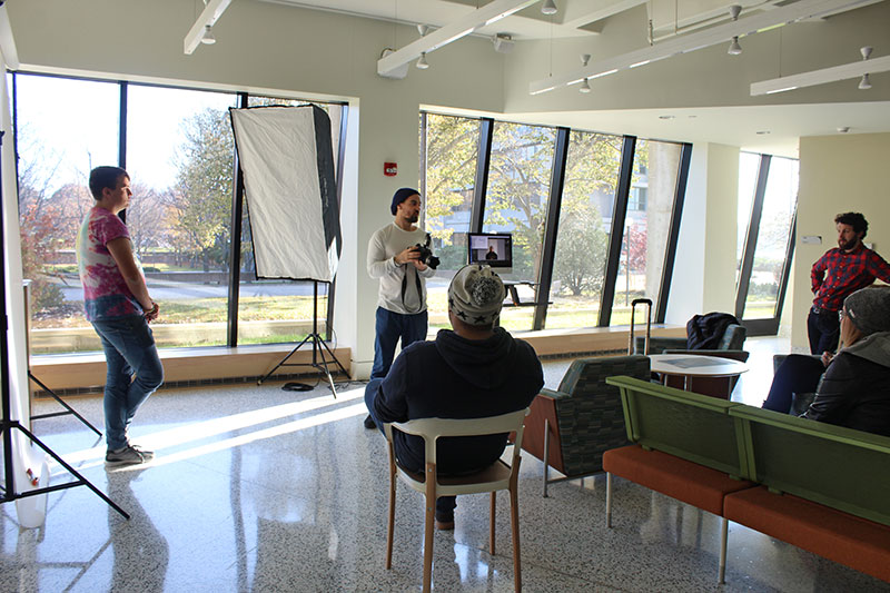 New York City-based photographer Mark Hartman (center) presents to students in Tyler Hall lobby