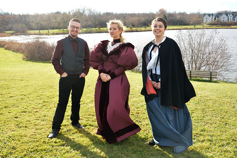 Director with actresses in costume promoting upcoming Dracula production