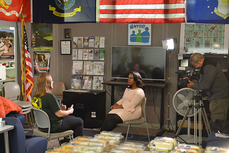 TV reporter interviews student veteran