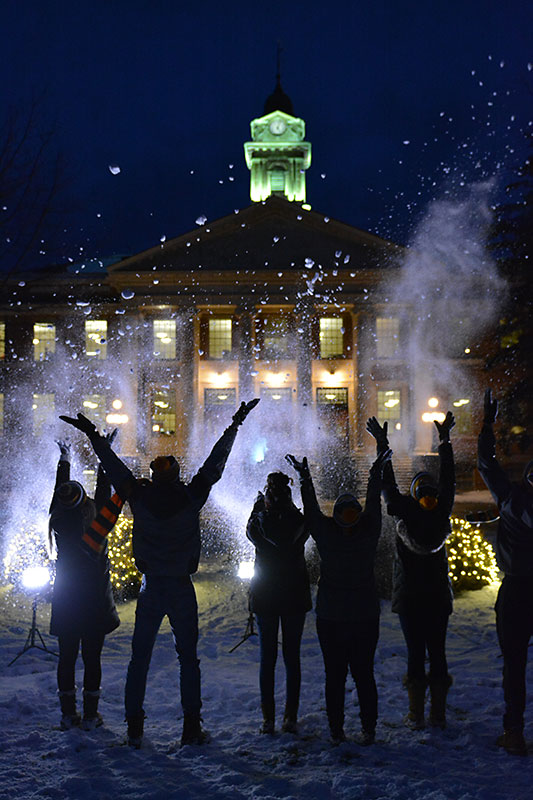Students having fun in snow in front of Sheldon Hall