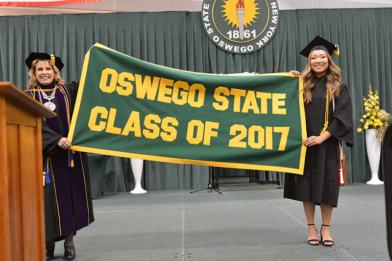 President Stanley and student hold Class of 2017 banner