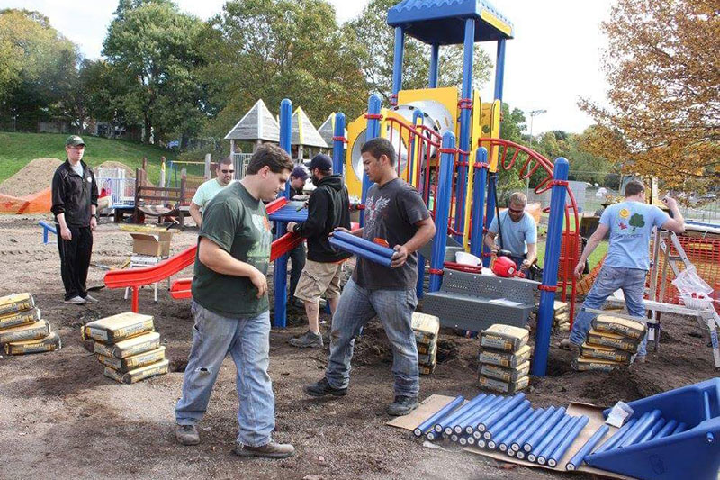Students, community members build playground