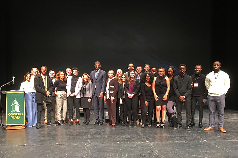 President Deborah F. Stanley, VP Jerald Woolfolk, speaker Bakari Sellers and students gather