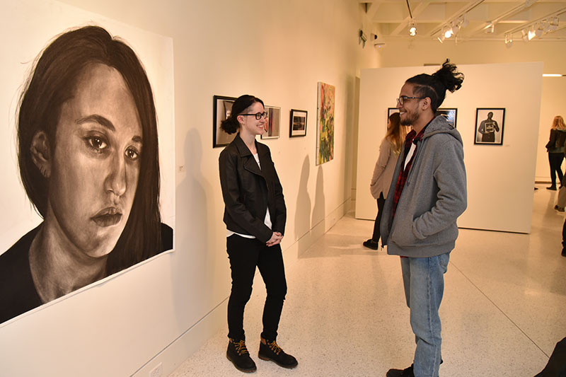 Students view juried student art exhibition