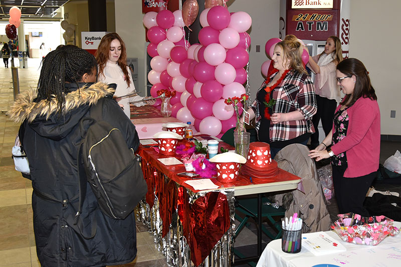 Volunteers greet students at Love a Donor Day event