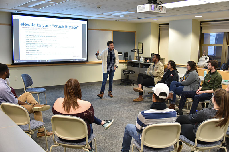 Alumnus Anthony DeMario speaks with students about sales and broadcasting