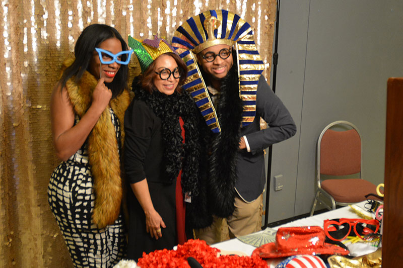 Visitors to Black Student Union 50th anniversary celebration dress up with props and costumes