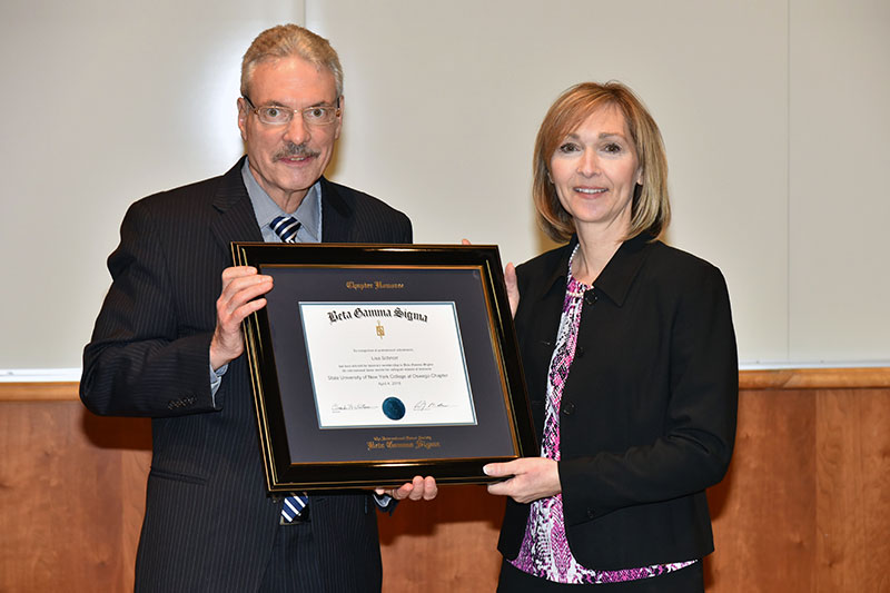 Lisa Marceau Schnorr recognized by Beta Gamma Sigma honor society