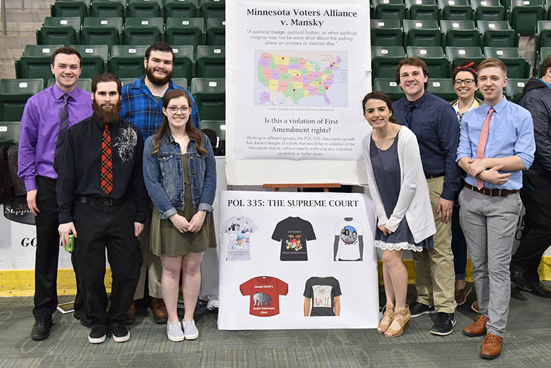 Political science students make poster presentation on free speech and campaigning
