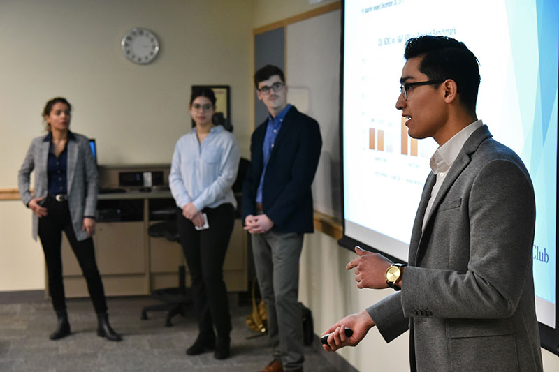 SUNY Oswego Investment Club members discuss stock selection