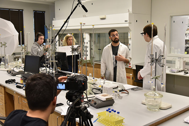 Students work on film about lab safety
