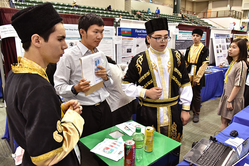 Two students from Azerbaijan explain research during GENIUS Olympiad