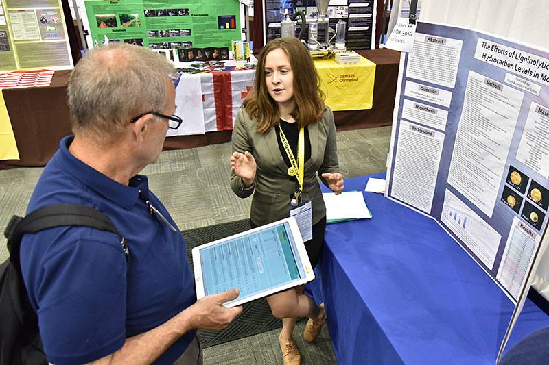 Noelani Rupp explains research at GENIUS Olympiad