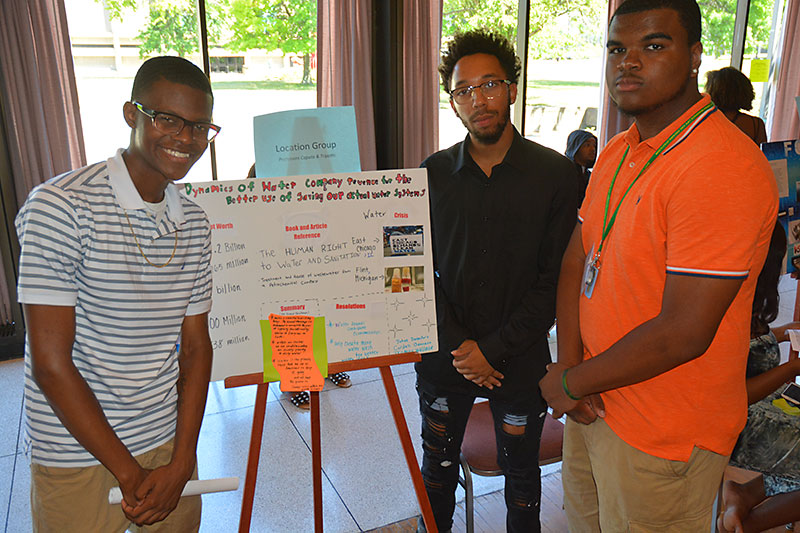 EOP students with conservation poster
