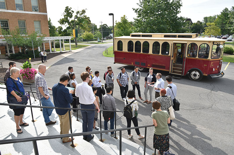 New employees learn about college history