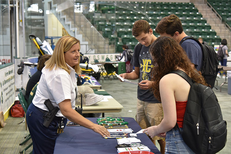 New University Police community relations officer Kelly Thompson speaks with students