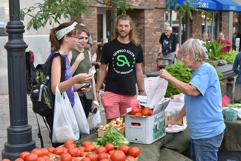 Students take part in College Night at Oswego Farmers Market
